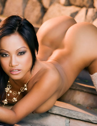 CJ Miles's naked creamy tan breasts and bare bottom are a perfect exotic and erotic compliment to her choice of the virgin white satin laced pant