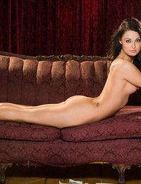 Melissa Jacobs lays back naked on a chocolate colored couch with her legs spread showing us the sheer beauty and raw erotic awesomeness of her pussy!