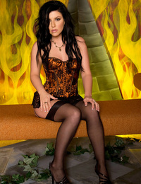 Taryn Thomas's tussled raven black hair and her pure white breasts and toned nude body provides a stark contrast to a fiery inferno background!