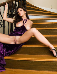Taya Parker's swanky purple evening dress suffers an intentional wardrobe malfunction while the hot, stacked brunette mounts the stairs of a long