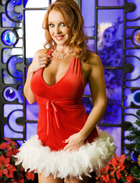 """Let me wrap my lips around your Christmas tree!"" grins the horny Mrs. Claus Janet Mason as she slowly unzips her sexy red velvet outfit whi"