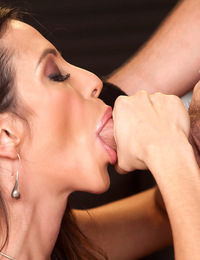 """C'mere, young blood,"" Ariella Ferrera playfully drawls at Billy Blaze as she grabs his big cock. Watch this classy honey slobber and s"